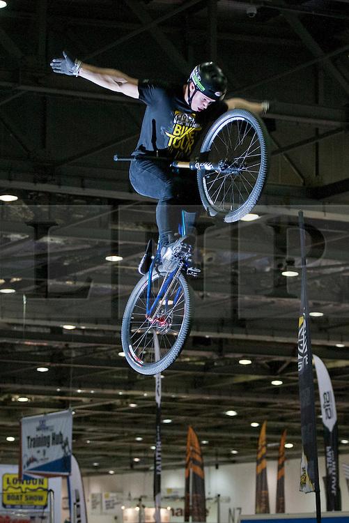 © licensed to London News Pictures. London, UK 12/01/12. Dirt jump star Blake Samson performing for Animal Bike Tour at the London Bike Show at the ExCel, London. Photo credit: Tolga Akmen/LNP
