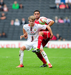 Bristol City's Derrick Williams jostles for the ball with Milton Keynes Dons' Patrick Bamford  - Photo mandatory by-line: Dougie Allward/JMP - Tel: Mobile: 07966 386802 24/08/2013 - SPORT - FOOTBALL - Stadium MK - Milton Keynes -  Milton Keynes Dons V Bristol City - Sky Bet League One