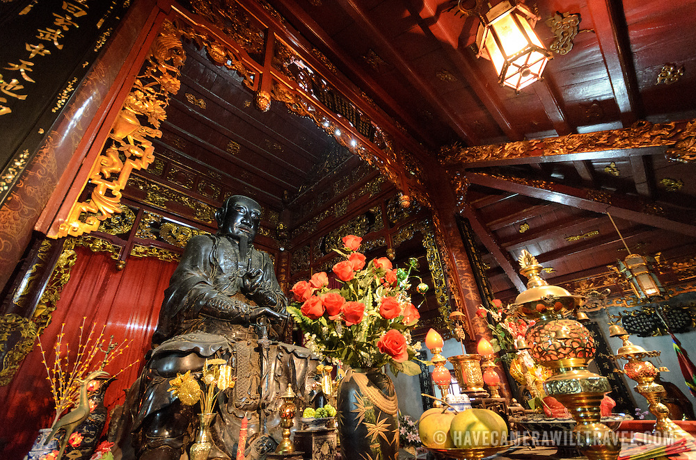 A large bronze statue sits in the middle of the main shrine at Quan Thanh Temple in Hanoi. The statue, measuring nearly 4 meters tall and weighing nearly 4 tons was cast in 1677 and depicts Huyen Thien Tran Vo, the God who administered the North and after whom the temple was originally named. The Taoist temple dates back to the 11th century and is located close to West Lake (Ho Tay).