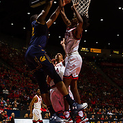 09 December 2017:  The San Diego State men's basketball team hosts the California Golden Bears Saturday afternoon. San Diego State Aztecs forward Jalen McDaniels (5) attempts to block the shot of California Golden Bears center Kingsley Okoroh (22) in the first half. The Aztecs trail 39-34 at halftime.<br /> www.sdsuaztecphotos.com
