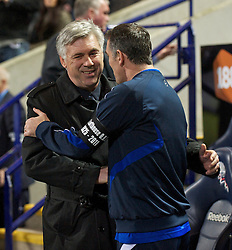 BOLTON, ENGLAND - Monday, January 24, 2011: Chelsea's manager Carlo Ancelotti and Bolton Wanderers' manager Owen Coyle during the Premiership match at the Reebok Stadium. (Photo by David Rawcliffe/Propaganda)