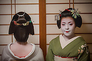 Fukuyu,geisha and Fukukimi,'maiko' (geisha apprentice). from Ishihatsu okiya (geisha house).Geisha's distric of Miyagawacho.Kyoto. Kansai, Japan.