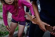 Alcuni bambini del campo nomadi di via Candoni, contestano la visita di Matteo Salvini e Giorgia Meloni, Roma 18 maggio 2016. Christian Mantuano / OneShot