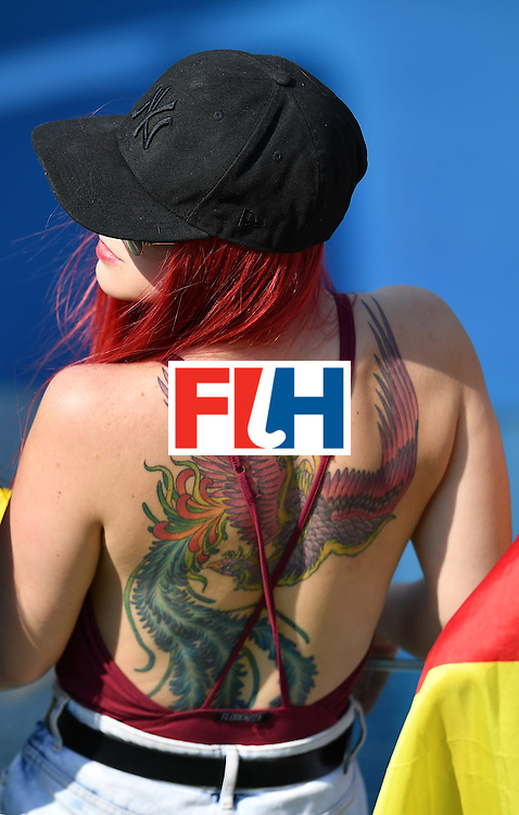 A spectator sporting a tatoo on her back attends the men's Bronze medal field hockey Netherlands vs Germany match of the Rio 2016 Olympics Games at the Olympic Hockey Centre in Rio de Janeiro on August 18, 2016. / AFP / MANAN VATSYAYANA        (Photo credit should read MANAN VATSYAYANA/AFP/Getty Images)