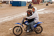 CANADA, Nunavut<br /> Inuit woman with child on a motorcycle