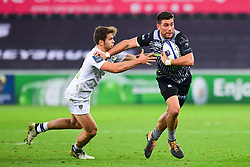Ospreys' Kieron Fonotia fends off Clermont Auvergne's Damian Penaud - Mandatory by-line: Craig Thomas/JMP - 15/10/2017 - RUGBY - Liberty Stadium - Swansea, Wales - Ospreys Rugby v Clermont Auvergne - European Rugby Champions Cup