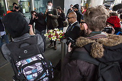 London, UK. 16th March, 2019. Maswood Ahmed, Assistant General Secretary of the Muslim Council of Britain, and Claudia Webbe, Labour NEC member, pause on the UN Anti-Racism Day march to leave flowers outside the New Zealand High Commission in tribute to the 49 people killed and 48 injured during a terror attack yesterday on two mosques in New Zealand by a far-right extremist.
