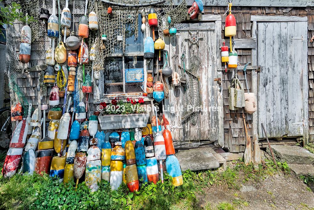 Decorative buoys against a shack in Lockport, Massachusetts, U.S.A