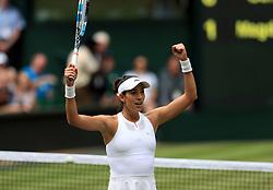 Garbine Muguruza celebrates reaching the Wimbledon women's singles final with a 6-1 6-1 semi-final victory against Magdalena Rybarikova on day ten of the Wimbledon Championships at The All England Lawn Tennis and Croquet Club, Wimbledon.