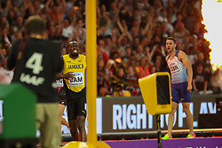 London, August 12 2017 . Usain Bolt, anchor for Jamaica, pulls up in in agony with a hamstring injury in the men's 4x 100m relay on day nine of the IAAF London 2017 world Championships at the London Stadium. © Paul Davey.