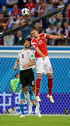 SAINT PETERSBURG, RUSSIA - Tuesday, June 19, 2018: Egypt's Ahmed Hegazy and Russia's Artem Dzyuba during the FIFA World Cup Russia 2018 Group A match between Russia and Egypt at the Saint Petersburg Stadium. (Pic by David Rawcliffe/Propaganda)