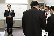 """These are recruits of Hartford Life Insurance K.K. in Japan undergoing an intensive three month training program to become """"Sales Consultants"""". Once they complete this training they will be posted to regional locations throughout Japan where they will work at getting banks and securities firms to handle Hartford insurance. This current training involves about fifteen men who are being trained by three female trainers. There are currently close to eighty Sales Consultants working for Hartford in Japan. This method of selling insurance through financial institutions is Hartford's main business model in Japan. These photos were taken at Hartford's Japan headquarters in Tokyo and the scene resembled something similar to actors taking dialog coaching."""