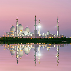 Exterior evening view of Sheikh Zayed Grand Mosque in Abu Dhabi United Arab Emirates