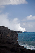 lava spilling into the ocean creating plumes of steam at Volcanoes National Park, Hawaii