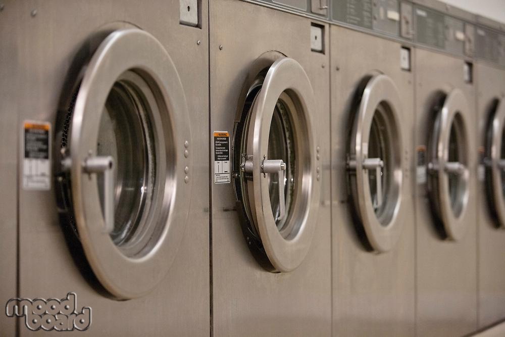 Row of self-service clothes dryer's door