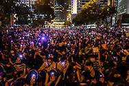 Thousands of people gather at Chater Garden in Kong Kong's Central district, part of a #MeToo rally to demand Hong Kong police answer accusations of sexual violence against protesters. (August 28, 2019)