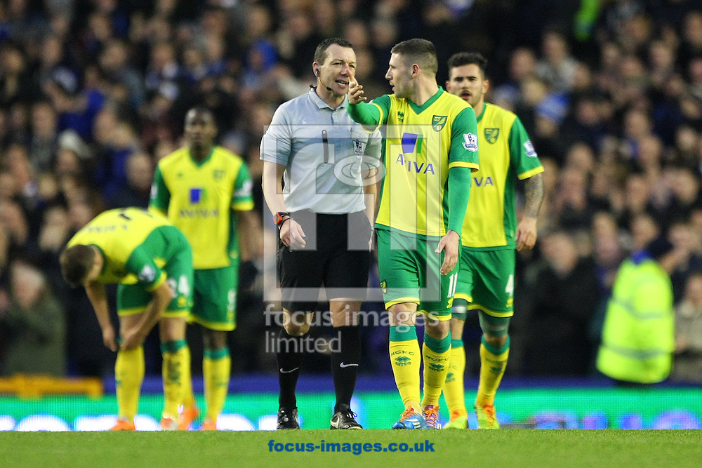 Picture by Paul Chesterton/Focus Images Ltd +44 7904 640267<br /> 11/01/2014<br /> Gary Hooper of Norwich protests to Referee Kevin Friend after Everton score their 2nd goal during the Barclays Premier League match at Goodison Park, Liverpool.