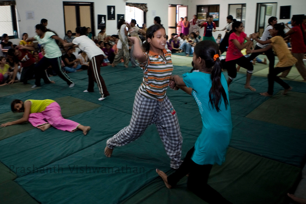 Students enact techniques to defend themselves incase of an attack, during a summer camp on self defence training an initiative by the Delhi Police and Special Police Unit for Women and Children at a police station hall in New Delhi, India, on Friday, June 6, 2011. Photographer: Prashanth Vishwanathan/HELSINGIN SANOMAT
