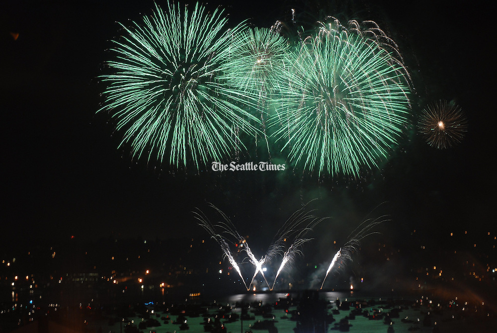 Green fireworks explode over Lake Union on the Fourth of July.<br /> Erika Schultz / The Seattle Times