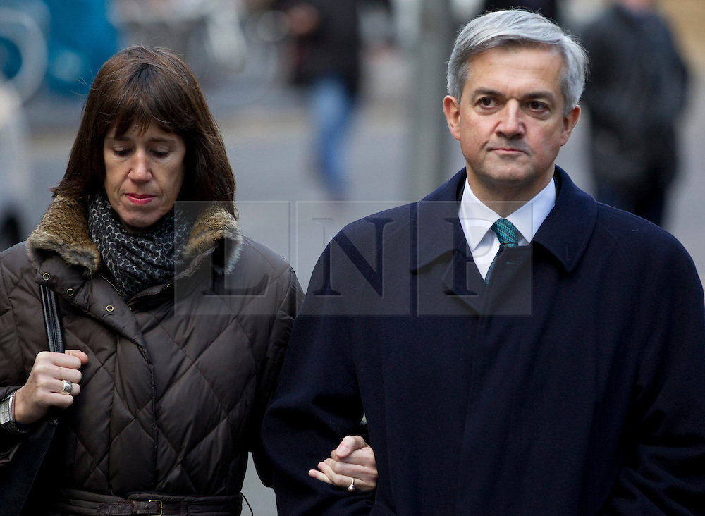 © Licensed to London News Pictures. 04/02/2013. London, UK. British MP Chris Huhne arrives at Southwark Crown Court in London today (04/02/13) with his partner Carina Trimingham at the start of a hearing where he faces charges of perverting the course of justice linked with a 2003 speeding case. Photo credit: Matt Cetti-Roberts/LNP