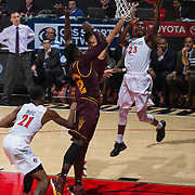 10 December 2016: The San Diego State Aztecs men's basketball team host's Saturday afternoon at Viejas Arena. San Diego State guard Montaque Gill-Caesar (23) goes up for layup against two Arizona State defenders in the first half. The Aztecs lead the Sun Devils 32-25 at half time. www.sdsuaztecphotos.com