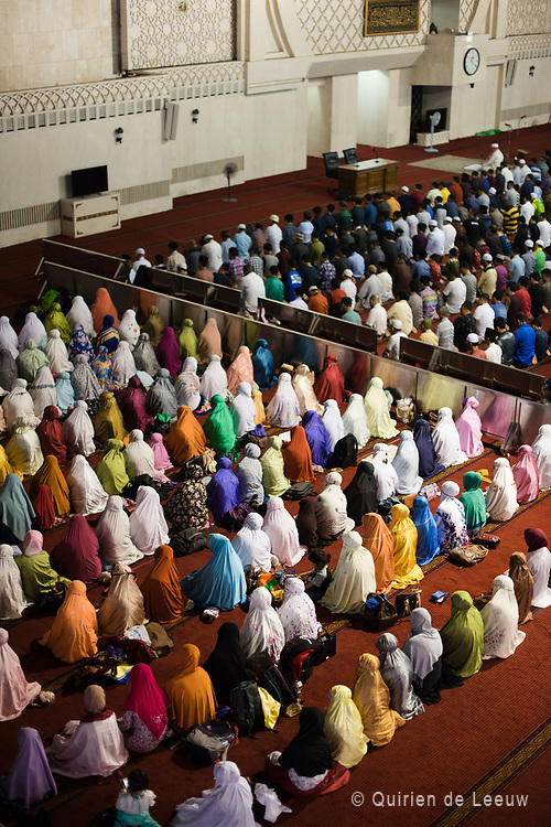 Muslim people pray in the Istiqlal Mosque located in Jakarta city. Istiqlal Mosque, or Masjid Istiqlal, (Independence Mosque) is the largest mosque in Southeast Asia