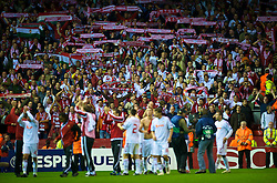 LIVERPOOL, ENGLAND - Wednesday, September 16, 2009: Debreceni's players applaud the supporters after his side's 1-0 defeat by Liverpool during the UEFA Champions League Group E match at Anfield. (Photo by David Rawcliffe/Propaganda)