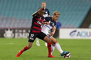 SYDNEY, AUSTRALIA - APRIL 27: Melbourne Victory midfielder Keisuke Honda (4) cottons the ball under pressure from Western Sydney Wanderers midfielder Keanu Baccus (17) at round 27 of the Hyundai A-League Soccer between Western Sydney Wanderers FC and Melbourne Victory on April 27, 2019 at ANZ Stadium in Sydney, Australia. (Photo by Speed Media/Icon Sportswire)