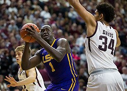 LSU forward Duop Reath (1) looks to shoot against Texas A&M center Tyler Davis (34) during the second half of an NCAA college basketball game Saturday, Jan. 6, 2018, in College Station, Texas. (AP Photo/Sam Craft)