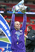 \Manchester City goalkeeper Wilfredo Caballero (13)  lifts the cup during the Capital One Cup match between Liverpool and Manchester City at Anfield, Liverpool, England on 28 February 2016. Photo by Simon Davies.
