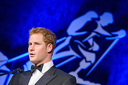 Prince Harry, Patron of the Walking With The Wounded South Pole Allied Challenge, attends the charity's Crystal Ball at the Grosvenor House Hotel, central London.<br /> The event hosted by Ben Fogle, with music Ellie Goulding and The Stereophonics. Also present were Olympian Matthew Pinsent CBE and Team Glenfiddich. The team of wounded service personnel will accompany the Prince on an expedition to the South Pole later this year, London,<br /> Thursday, 30th May 2013<br /> Picture by Anthony Upton / i-Images