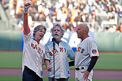 August 9, 2011; San Francisco, CA, USA;  Grateful Dead band members Phil Lesh (left) and Bob Weir (center) sing the national anthem with San Francisco Giants third base coach Tim Flannery (right) before the game against the Pittsburgh Pirates at AT&T Park.