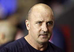 "Wigan Athletic manager Paul Cook during the Sky Bet Championship match at the DW Stadium, Wigan. PRESS ASSOCIATION Photo. Picture date: Friday September 21, 2018. See PA story SOCCER Wigan. Photo credit should read: Martin Rickett/PA Wire. RESTRICTIONS: EDITORIAL USE ONLY No use with unauthorised audio, video, data, fixture lists, club/league logos or ""live"" services. Online in-match use limited to 120 images, no video emulation. No use in betting, games or single club/league/player publications."