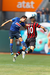 July 16, 2011; San Francisco, CA, USA;  Club America defender George Corral (34) and Manchester City forward Edin Dzeko (10) jump for a loose ball during the first half at AT&T Park. Manchester City defeated Club America 2-0.