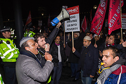 London, UK. 4th February, 2019. Hundreds of Uber minicab drivers protest outside City Hall after having left their vehicles blocking London Bridge as part of a protest organised by the United Private Hire Drivers (UPHD) branch of the Independent Workers Union of Great Britain's (IWGB)  following the introduction in December of congestion charges for minicabs.
