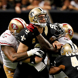 November 25, 2012; New Orleans, LA, USA; San Francisco 49ers outside linebacker Ahmad Brooks (55) and inside linebacker Patrick Willis (52) combine to sack New Orleans Saints quarterback Drew Brees (9) during the second half of a game at the Mercedes-Benz Superdome. The 49ers defeated the Saints 31-21. Mandatory Credit: Derick E. Hingle-US PRESSWIRE