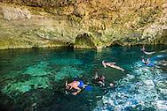 Exploring Cenote Dos Ojos, an underground swimming hole, near Tulum, Mexico.