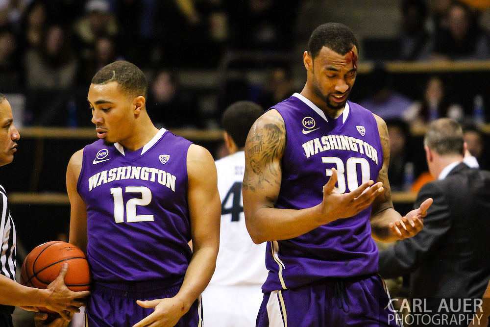 February 9th, 2014:  Washington Huskies junior forward Desmond Simmons (30) heads to the bench after a elbow drew blood from his forehead in the first half of action in the NCAA Basketball game between the Washington Huskies and the University of Colorado Buffaloes at the Coors Events Center in Boulder, Colorado