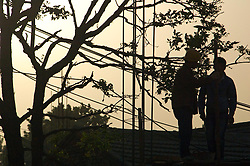 China, Beijing, Chaoyang, San Jian Fang, 2008. Working until well after sunset, a construction crew keeps up a steady pace through the early summer heat in Beijing.