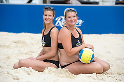 Image ©Licensed to i-Images Picture Agency. 30/07/2014. London, United Kingdom. Zara Dampney and Lucy Boulton take part in a pop up beach volleyball event.<br /> Pic Shows Zara Dampney (dark hair) and Lucy Boulton (blonde). Picture by i-Images
