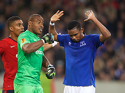 LILLE, FRANCE - Thursday, October 23, 2014: Everton's Samuel Eto'o and Lille OSC's goalkeeper Vincent Enyeama during the UEFA Europa League Group H match at Stade Pierre-Mauroy. (Pic by David Rawcliffe/Propaganda)