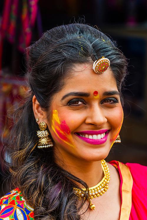 Beautiful Indian woman, Holi (Festival of Colors), Mathura, Uttar Pradesh, India.