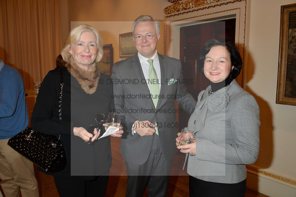 LONDON, ENGLAND 28 NOVEMBER 2016: Left to right, Marie-Louise Bernenburg, Jean Claude Kugener and Pascale Kugener at a reception to celebrate the publication of The Sovereign Artist by Christopher Le Brun and Wolf Burchard held at the Royal Academy of Art, Piccadilly, London, England. 28 November 2016.