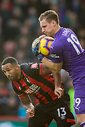Callum Wilson (Bournemouth) & Bernd Leno (GK) (Arsenal) go for the ball saves by Leno during the Premier League match between Bournemouth and Arsenal at the Vitality Stadium, Bournemouth, England on 25 November 2018.
