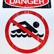 Swimming warning sign at Cylinder Beach on Stradbroke Island, Queensland. The islands long beaches fronting the open ocean can often get a strong current running along them. North Stradbroke Island, just off Queensland's capital city of Brisbane, is the world's second largest sand island and, with its miles of sandy beaches, a popular summer holiday destination.