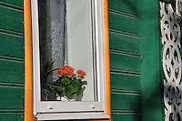 """The cheerful colors of a home with traditional wood scrolls in Uglich, Russia. As one of Russia's """"Golden Ring"""" cities, Uglich is designated a town of significant cultural and historic importance."""