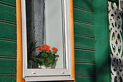 "The cheerful colors of a home with traditional wood scrolls in Uglich, Russia. As one of Russia's ""Golden Ring"" cities, Uglich is designated a town of significant cultural and historic importance."