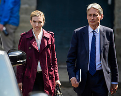 © Licensed to London News Pictures. 18/05/2017. Halifax, UK.  Chancellor PHILIP HAMMOND with his special advisor POPPY TROWBRIDGE the Conservative Party manifesto at The Arches in Halifax, West Yorkshire. The Conservatives are the last of the three main parties to launch their manifesto ahead of a snap general election called for June 8, 2017. Photo credit: Ben Cawthra/LNP