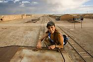 Two single women travelers waiting for a train in Colchani next to the Salar de Uyuni in Bolivia.
