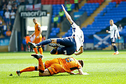 Wolverhampton Wanderers midfielder Ruben Neves (8) fouls Bolton Wanderers midfielder Will Buckley (11)  during the EFL Sky Bet Championship match between Bolton Wanderers and Wolverhampton Wanderers at the Macron Stadium, Bolton, England on 21 April 2018. Picture by Simon Davies.
